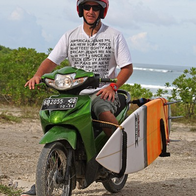 A motorbike with a surf-board rack is a great way for surfers to explore the area around Afulu.