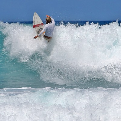 Surfing off the north end of Pasir Merah Beach on the west-coast of North Nias.