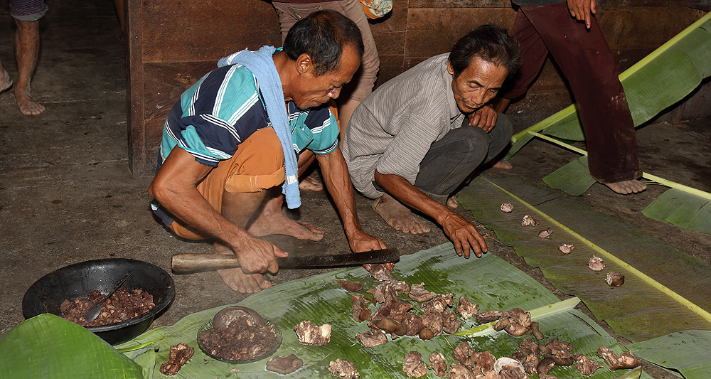 Pork meat prepared for guests is shared with villagers according to a traditional protocol in use to this day.