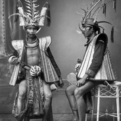 Studio portrait of two warriors from South Nias. National Museum of World Cultures. Collection number: TM-60042492.