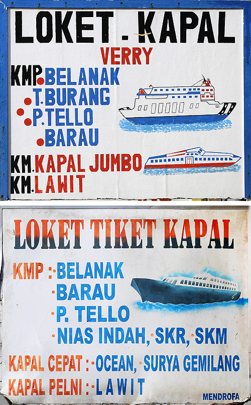Signs for ferry tickets near the harbour in Gunung Sitoli