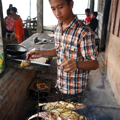 Grilled fish (Ikan Bakar) is a Nias specialty popular with locals and tourists alike. Asi Walo Beach, North Nias Regency.