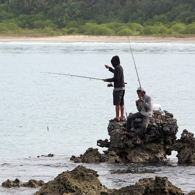 Fishing is a very popular past time with local people. Walo Beach, North Nias Regency (Nias Utara).