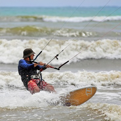 Australian Eddie Morgan Kite surfing on a windy day. La'fau Beach, North Nias Regency (Nias Utara).