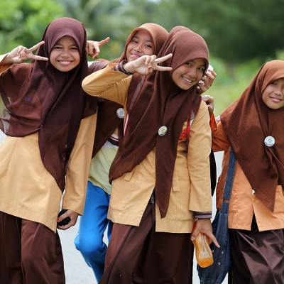 School girls in Lahewa posing for the camera. North Nias (Nias Utara), Indonesia.