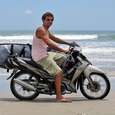 Australian surfer Jake Roberts looking for waves on the west-coast of North Nias.