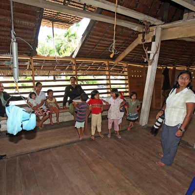Tourism & Culture office staff visiting a traditional house in near Lotu, North Nias Regency (Nias Utara).