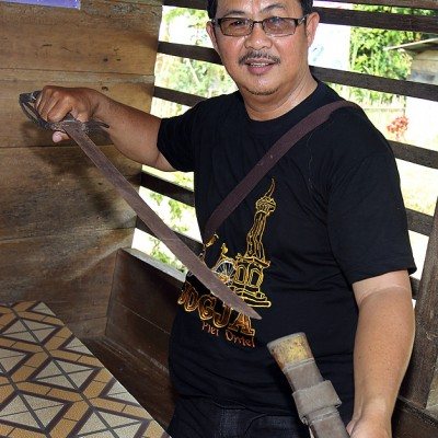 Head of North Nias culture section Mr Ingati Waruwu with an old weaponry from a traditional village in Tugala Oyo sub-district.