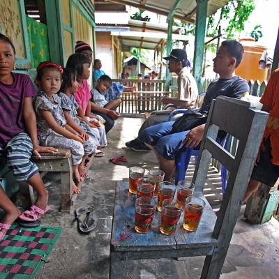 The survey team invited for tea in village that can only be reached on foot or by boat. Turezouliho village, North Nias Regency (Nias Utara).