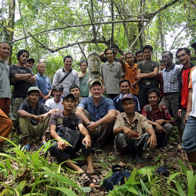 Bjorn Svensson from the North Nias tourism office with local people during a survey of remote megaliths at an abandoned village site.